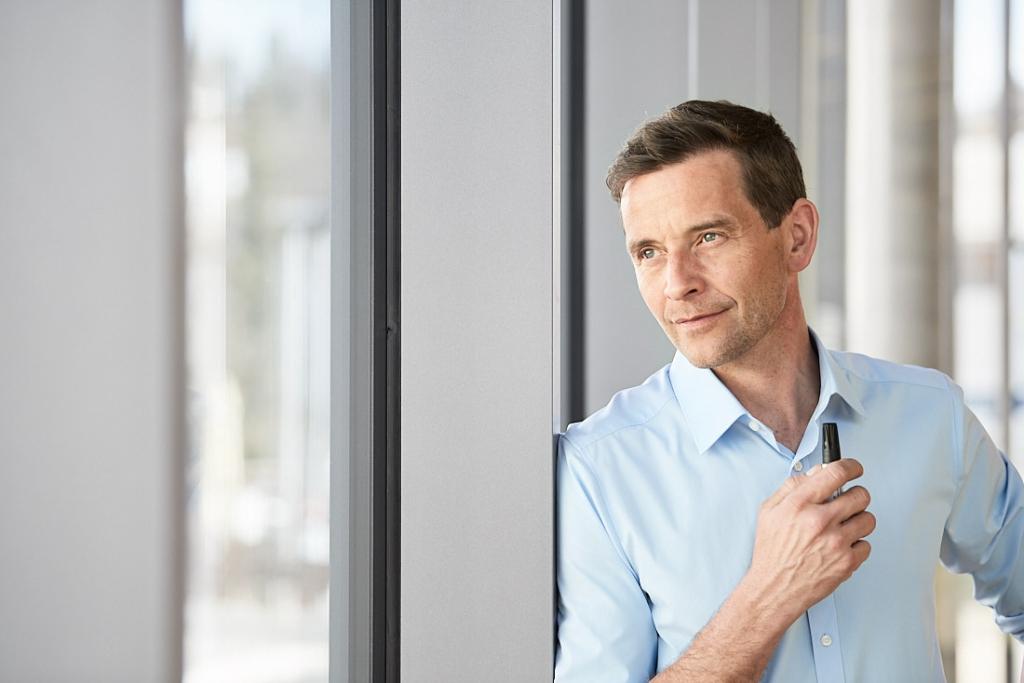 Businessfotograf in Baden-Wuerttemberg für Businessfotoshooting, BusinessPeople, Manager bei der Arbeit, BusinessPortraits