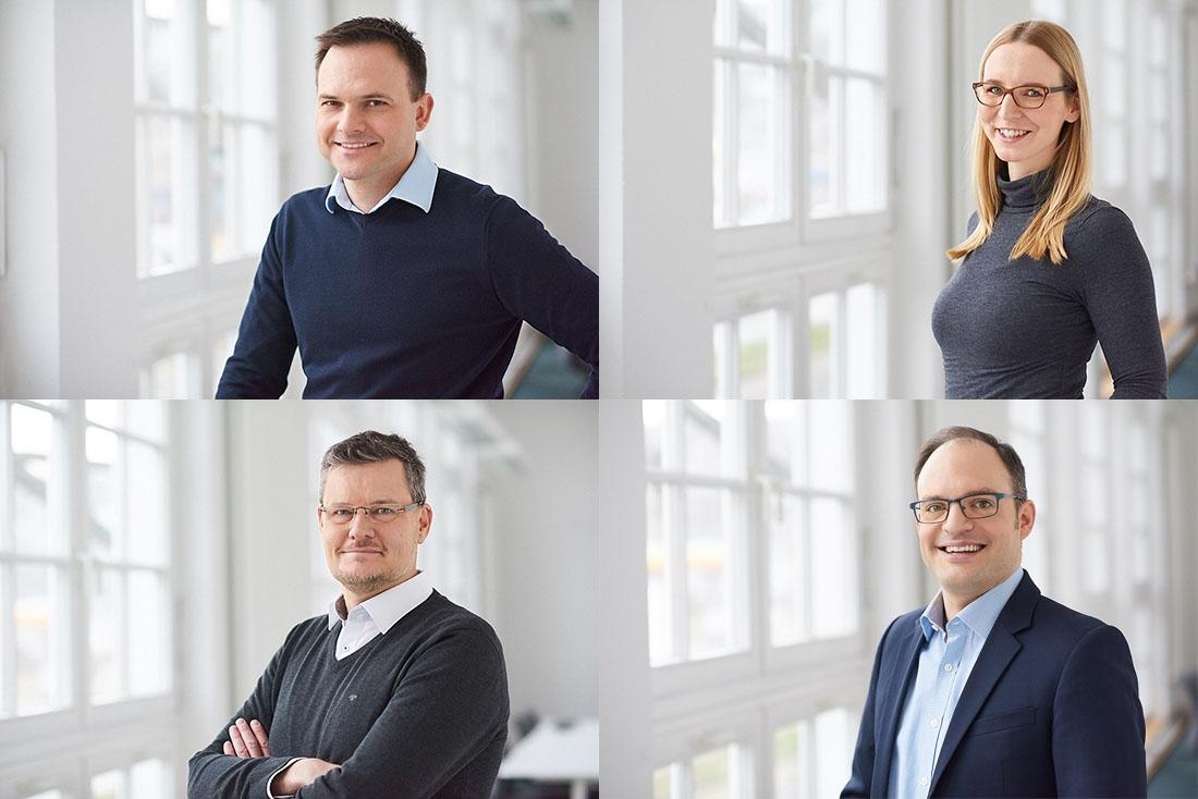 Einheitliche Mitarbeiterfotos im hellen Business Look mit unscharfem Hintergrund